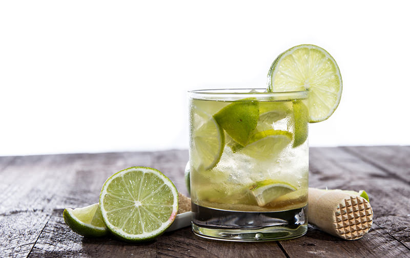 Table with Caipirinha isolated on white background