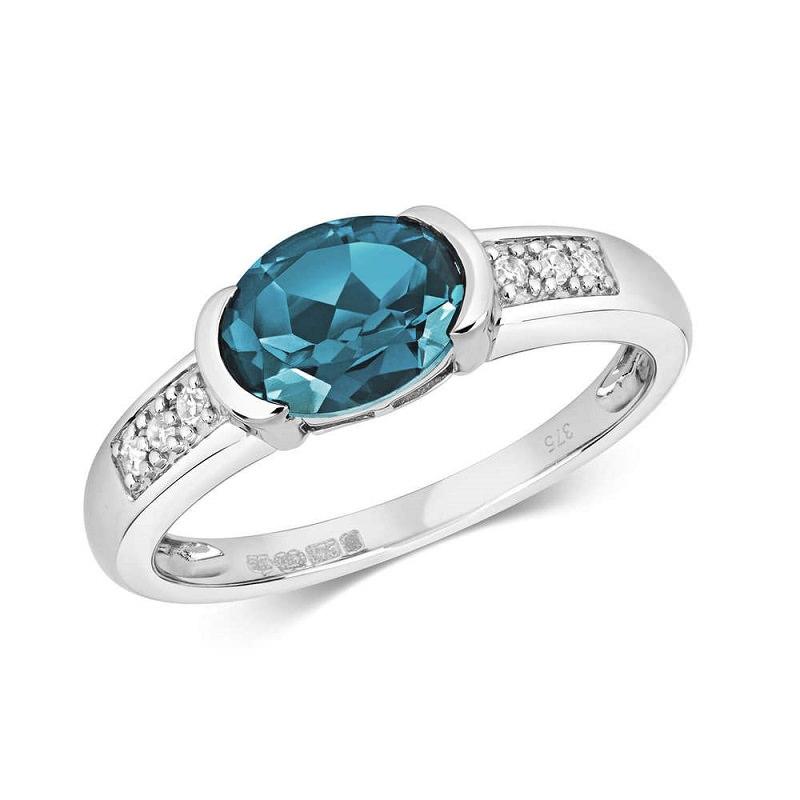 10-anel-de-noivado-discreto-topazio-azul-oval-pequeno